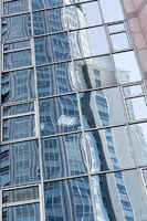 reflection in glass wall of skyscraper