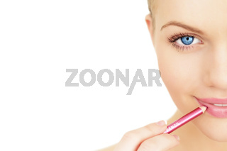 Applying lipstick using lip concealer brush isolated on a white background