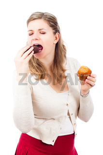 Woman enjoying chocolate donut and muffin