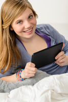 Happy young girl using digital tablet