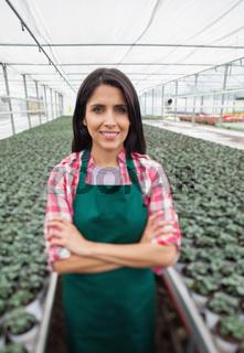 Greenhouse worker smiling in greenhouse nursery