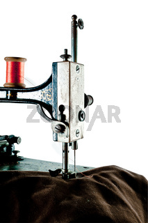 Detail of antique sewing machine, isolated