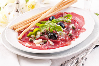 Carpaccio with Parmesan and olives