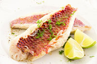 fish fillet with fresh lime and herbs
