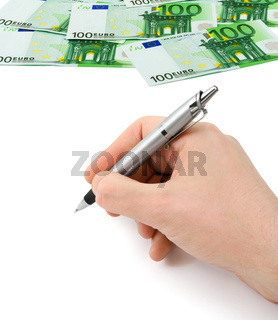 Hand with pen and money