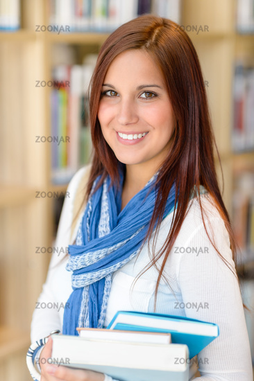 Female student carry education books from library