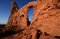 Hiker Exploring the Turret Arch in Arches National Park at Sunrise