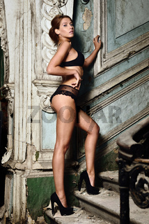 beautiful woman in lingerie in studio with palace interior.