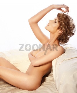 Sensual naked woman relaxing
