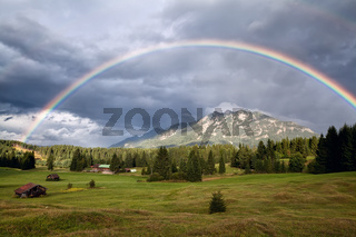 rainbow over Karwendel Alps and meadows
