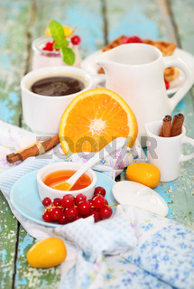 Delicious breakfast with fresh coffee, fresh waffles and fruits