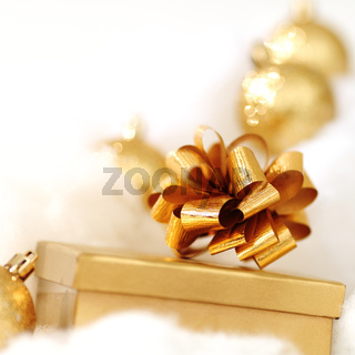 golden gifts on white close up