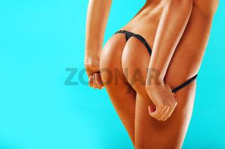 Female buttocks in a g-string