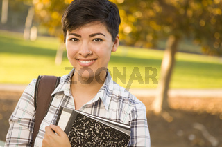 Portrait of a Pretty Mixed Race Female Student Holding Books