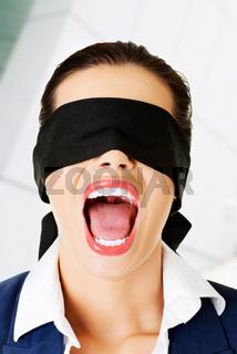 Beautiful frighten young blindfold woman