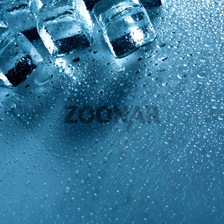 Ice with water droplets over abstract wet background