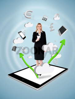 Smiling businesswoman holding a coffee on a tablet pc