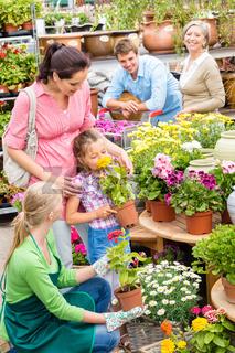 Family garden center shopping for flowers