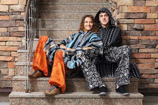 Hippie couple sitting on the steps
