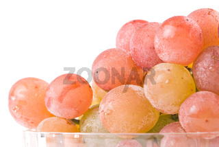 Red grape fruit in glass bowl.