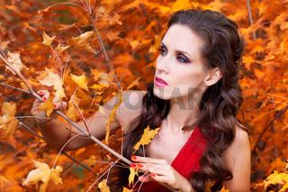 A beautiful brunette in red dress