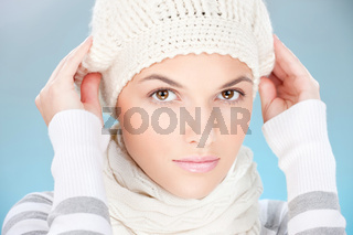 woman with scarf and winter cap