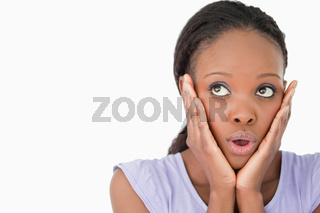 Close up of woman being afraid against a white background