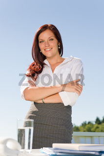 Businesswoman outside nature blue sky office smile