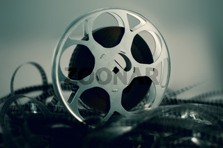 Film reel with celluloid around green atmosphere