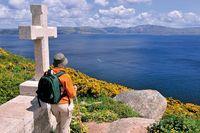 Spanien: Pilgerin am Kap Fisterra