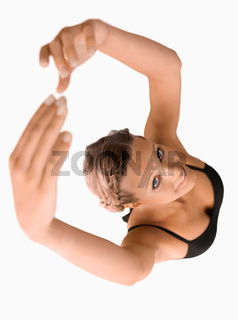 Overhead view of stretching woman