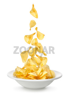 Potato chips falling in the plate