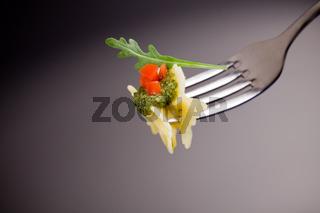 Pasta with Arugula Pesto and Tomatoes