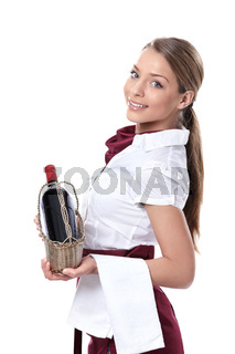 A waitress with a bottle of wine
