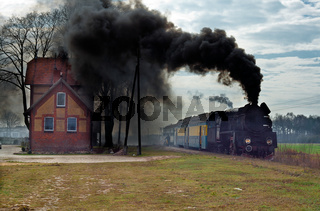 Old retro steam train stopped at the small station