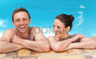 Lovely couple  in the swimming pool