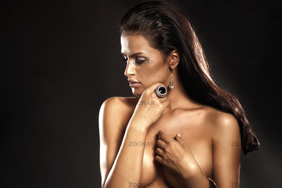 Portrait of beautiful brunette lady with amazing ring