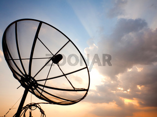 satellite dish over sunset sky
