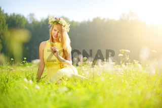 smiling girl relaxing on green meadow