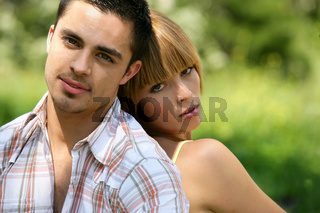 Couple sat relaxing in the park