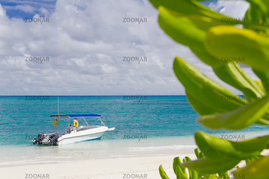 Lonely white boat in the blue tropical lagoon