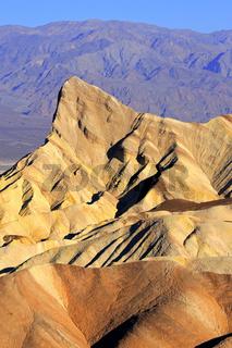 farbige Gesteinsformationen bei Sonnenaufgang am Zabriske Point,