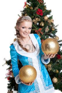 Sexy christmas girl smile and hold gold balls