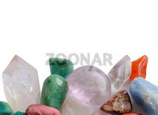 Semiprecious stones margin isolated on white