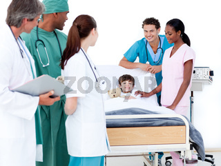 Positive medical team taking care of a little boy