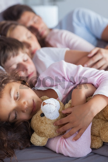 Cute family napping together