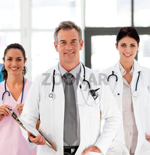 Senior Smiling doctor with his colleagues