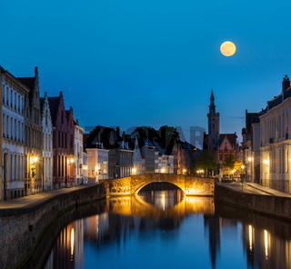 European medieval night city view background - Bruges (Brugge) canal in the evening