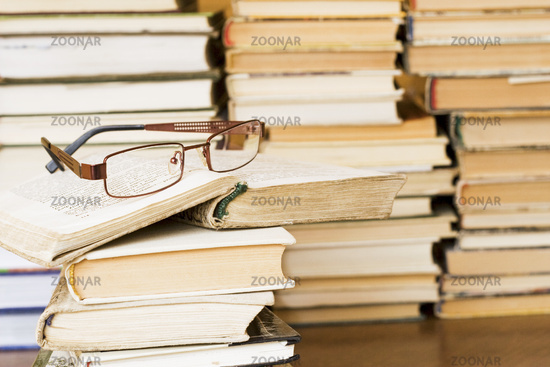 glasses on stack of books