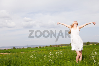 beautiful blonde woman outdoor in summer happy